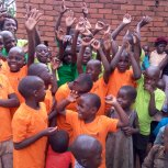 Safo children waving.