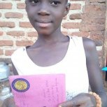 Pictures of two girls receiving letters at Samaritan Foundation Orphanage.