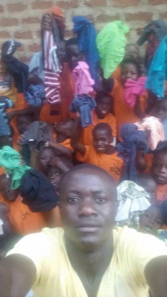 Children receive T Shirts at Butiiki Children's Ministry